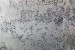 Cracked paint on rusty iron background texture
