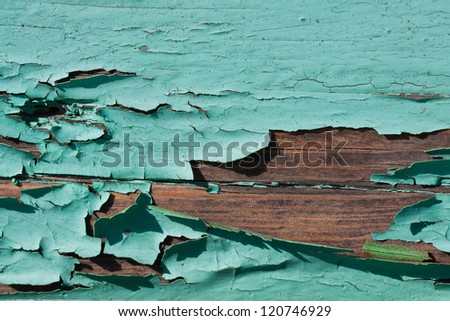 cracked paint on wooden surface