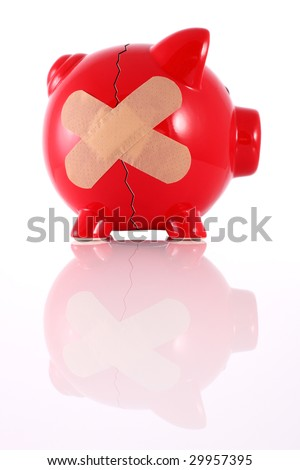 Cracked piggy bank with plaster representing financial problems