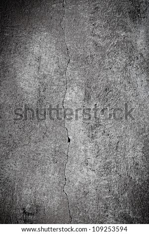 Cracked plaster concrete wall wallpaper background - black and white - stock photo
