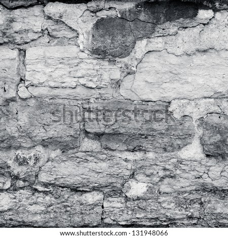 cracked plaster stone wall in black and white colors