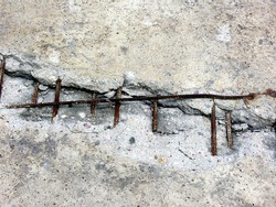 Cracked reinforced concrete monolith. Reinforcement wires visible