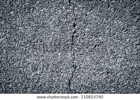 Cracked small granite stonewall background