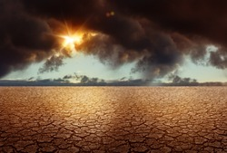 Cracked Soil - Global Warming Climate Changing Concept with Stormy Clouds on Background. Grunge Earth Backdrop.