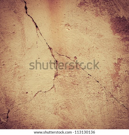 Cracked square orange wall wallpaper background
