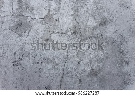 Cracked stone texture plastered white walls. Vintage cracks in white wall surface. Web small cracks on surface of white background. Traces of destruction of  old cement wall #586227287