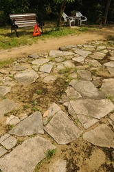 Cracked stone walkway at Lorong Buangkok ancient village in Singapore.