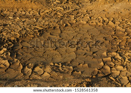 Cracked surface. Cracked dirt stock image. #1528561358