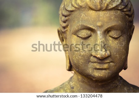 Cracked surface of old Buddha statue, decline of Buddhism concept