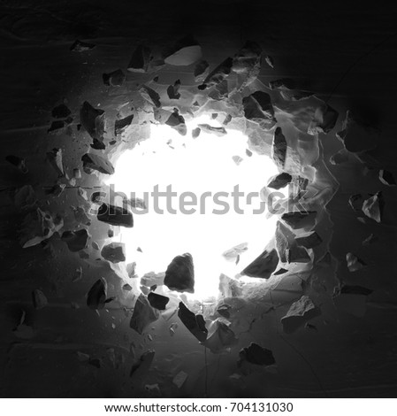 cracked wall with hole and debris in low key Foto d'archivio ©
