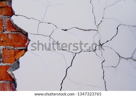 Cracked white grunge brick wall textured background stained old #1347323765