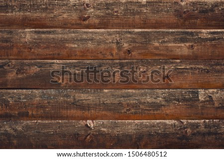 Cracked wood background. Brown old wooden planks. Horizontal lines on fence. Vintage rustic pattern. Timber plank, scratched surface. Dirty wall, grunge texture. Shabby table. Vintage style.