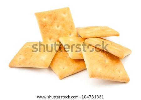 crackers pile on white background - stock photo
