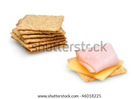 Crackers with Ham and Cheese isolated on white background with clipping path