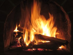 Crackling fire in wood-burning fireplace