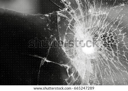 Cracks and scratches on black surface, background, texture