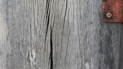 Cracks of wooden pillars, old wood poles with patterns caused by long use