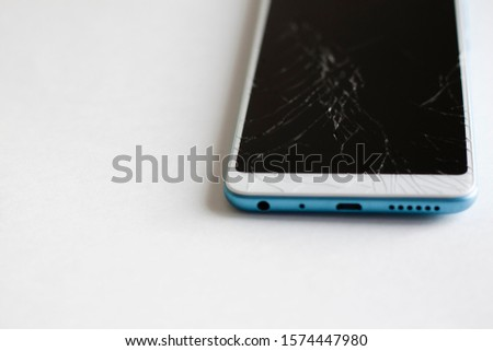 Cracks on the black screen of a mobile phone on a white background #1574447980