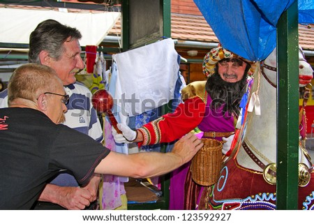 CRACOW, POLAND-JUNE 14: Lajkonik passes through the town, who touches it will have good luck, Cracow, June 14 2007. Lajkonik is one of the symbols of the Cracow.