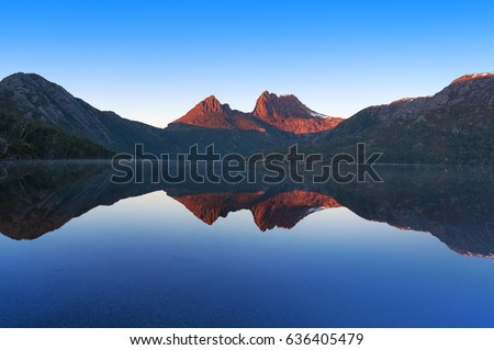 Cradle Mountain landscape perfectly reflected in mirror like water surface of lake Dove. Cradle Mountain National Park, Tasmania, Australia #636405479