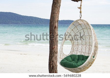 Cradle under the tree on beach. #569680228
