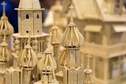 craft, art, handmade concept. close up of extremelly popular wooden construction set, it composes one of the finest russian sightseeing and architecture monument cathedral of vasily the blessed