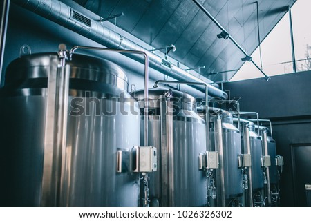 Craft beer brewing equipment in brewery! Metal tanks, alcoholic drink production Stock photo ©