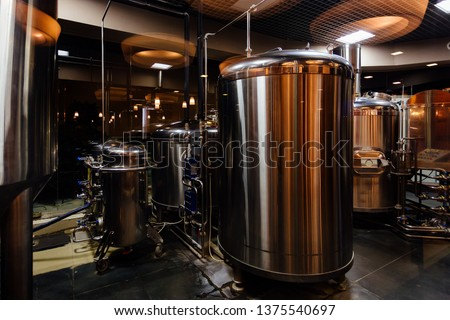 Craft beer production line in private microbrewery. #1375540697