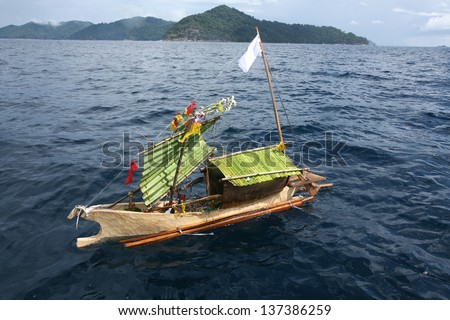 Craft boat floating in ceremony for respect to ancestor of Sea Gypsies moken Thailand