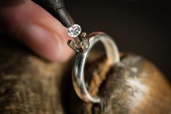 Craft jewelery making. Ring repairing. Putting the diamond on the ring. Macro shot.
