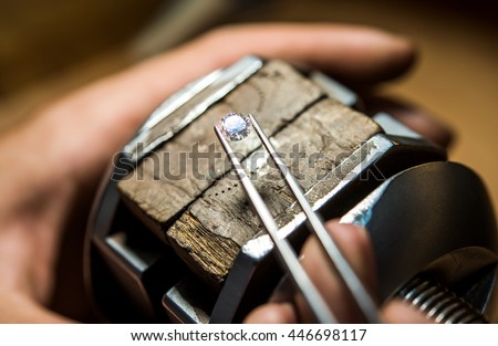 Craft jewelery making with professional tools. Ring repairing. Putting the diamond on the ring. Macro shot.  A handmade jeweler process, manufacture of jewelery. Сток-фото ©