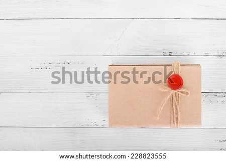 Craft package gift box on white wooden background