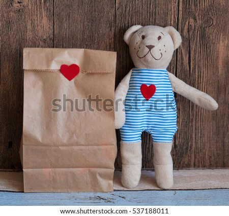 Craft paper bag and teddy bear. Gift on valentine's day. #537188011