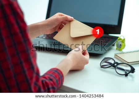 Craft paper envelope with a letter. Written correspondence. Receive and send messages. Message concept
