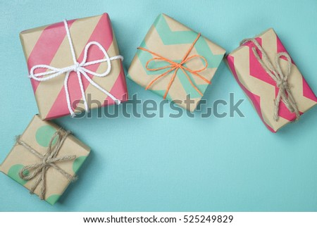 craft paper present boxes tied from rope on blue background, top view #525249829