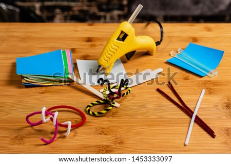 Crafting and Scrapbooking for relaxation, education and family time.  Hot Glue guns and glue sticks are often an important part of crafting.  Bugs are a popular pipe cleaner craft for kids.