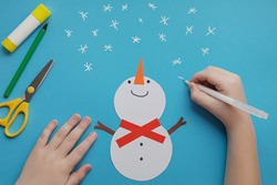 Crafts for children. little Child making winter decoration from paper. Children's art project. DIY concept. Handmade Easy Paper Crafts For Kids
