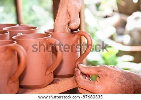 Craftsman creating new pottery cup in clay