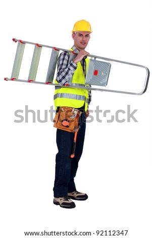 craftsman holding a ladder - stock photo