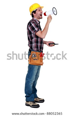craftsman holding a walkie talkie and shouting through a megaphone
