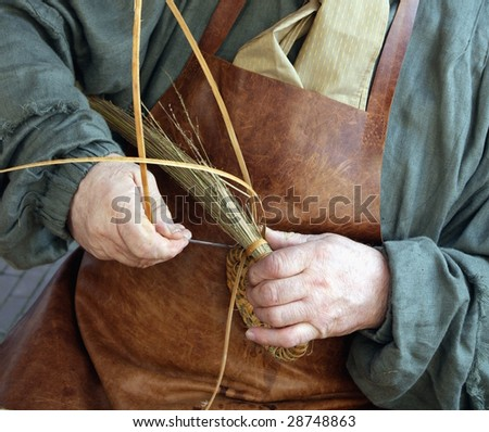 Craftsman making a basket out of weed