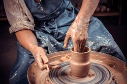 Craftsman master making ceramic pot on the pottery wheel . Concept for woman in freelance, business, hobby. Close-up.