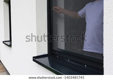 Craftsman mounts a fly screen in a window #1403485745