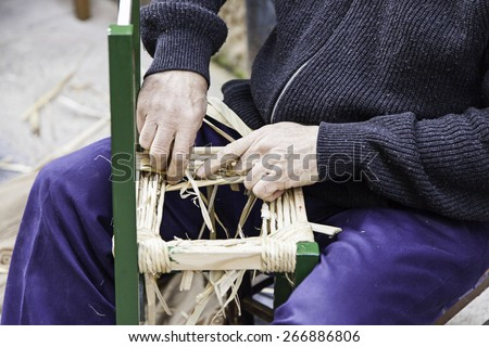 Craftsman wicker person working with his hands, arts and crafts