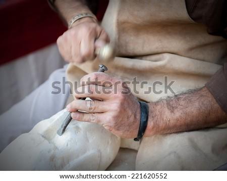craftsman working on stone...