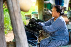 Craftsmen of Thai indigo cotton. Indigo in the jar Indigo is used for dyeing cotton in natural colors. Is the wisdom of Thailand