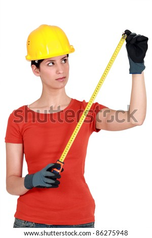 craftswoman holding a meter