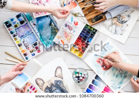 crafty room. artful studio. creative painter workspace. paintings drawings and watercolors on the table. artists at work