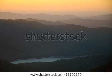 Craggy Gardens overlook and Burnett Reservoir of mountains at sunrise - stock photo