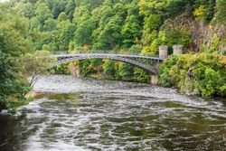 Craigellachie Bridge, a cast iron arch bridge across the River Spey at Craigellachie, near to the village of Aberlour in Moray, Scotland. The bridge was built from 1812 to 1814.